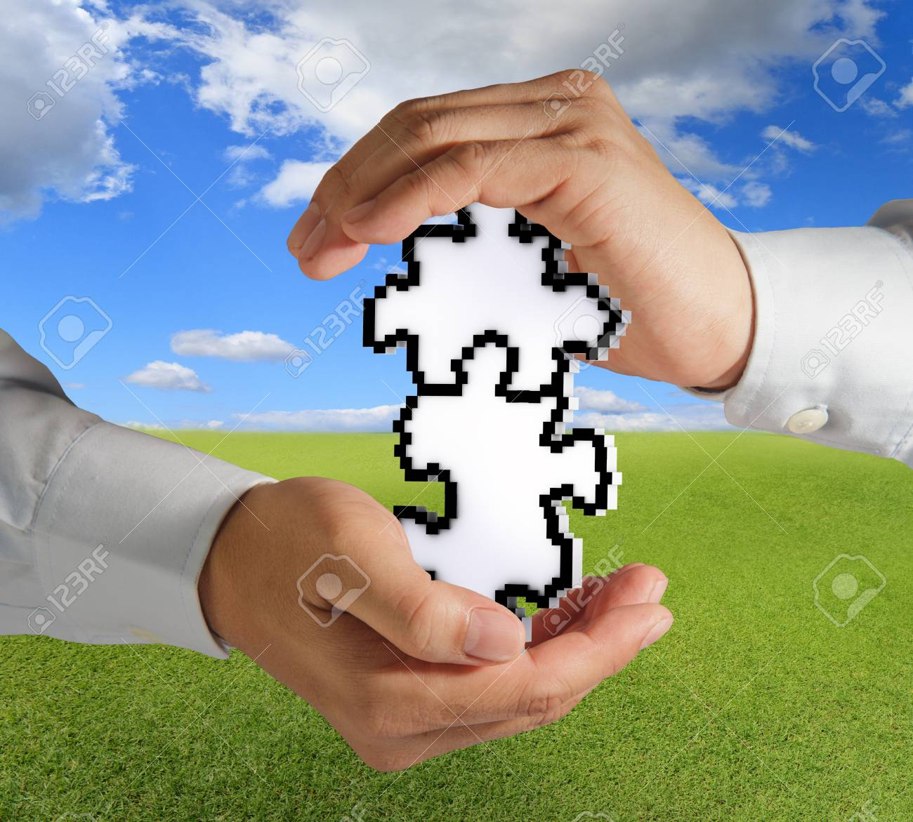 close up of hands hold pixel puzzles as partnership concept Stock Photo - 13652516