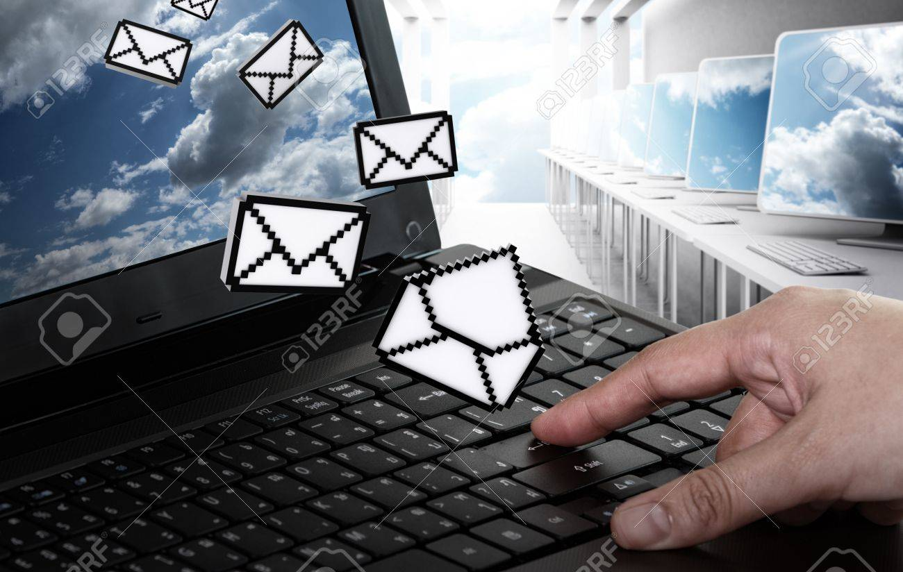 hand pushing laptop computer with pixel e-mail icon and sun and sky Stock Photo - 13974192