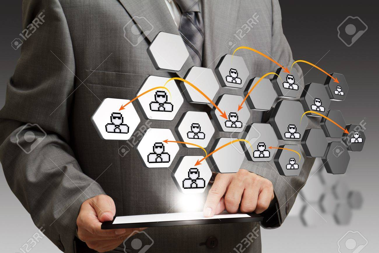 business man hand using tablet computer and abstract icon as social network concept Stock Photo - 14161837