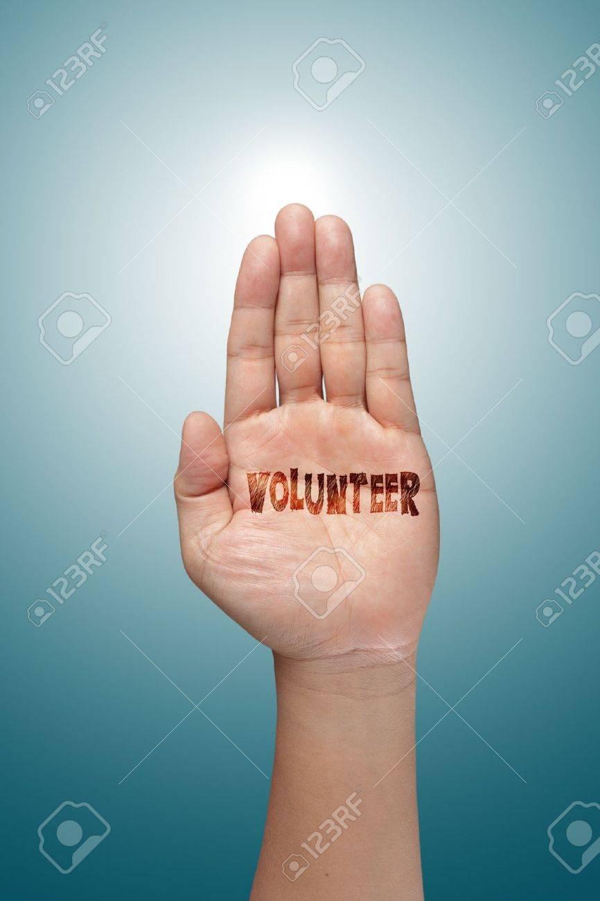 volunteer raising hand against blue sky backgroun - 14731723