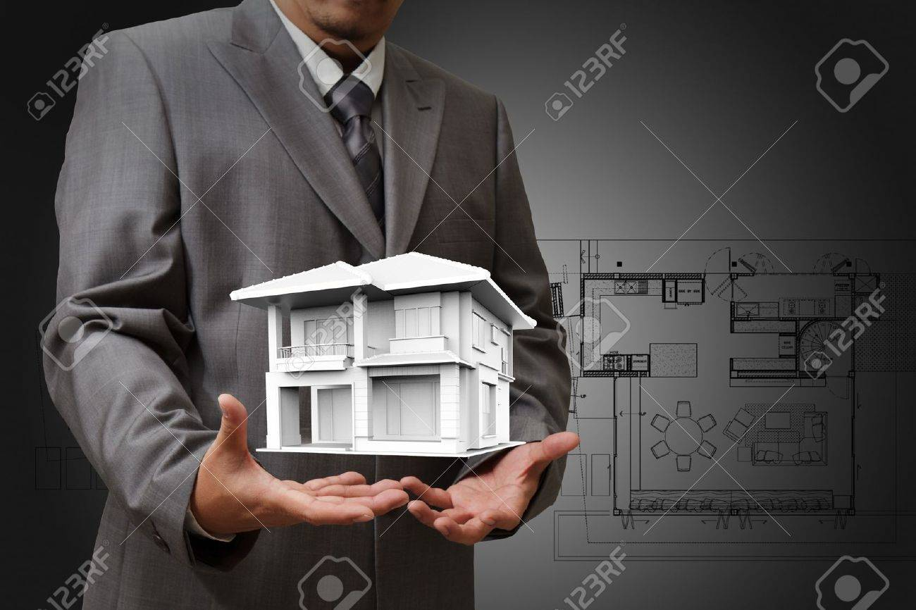 The house in hands on blue print Stock Photo - 14765495