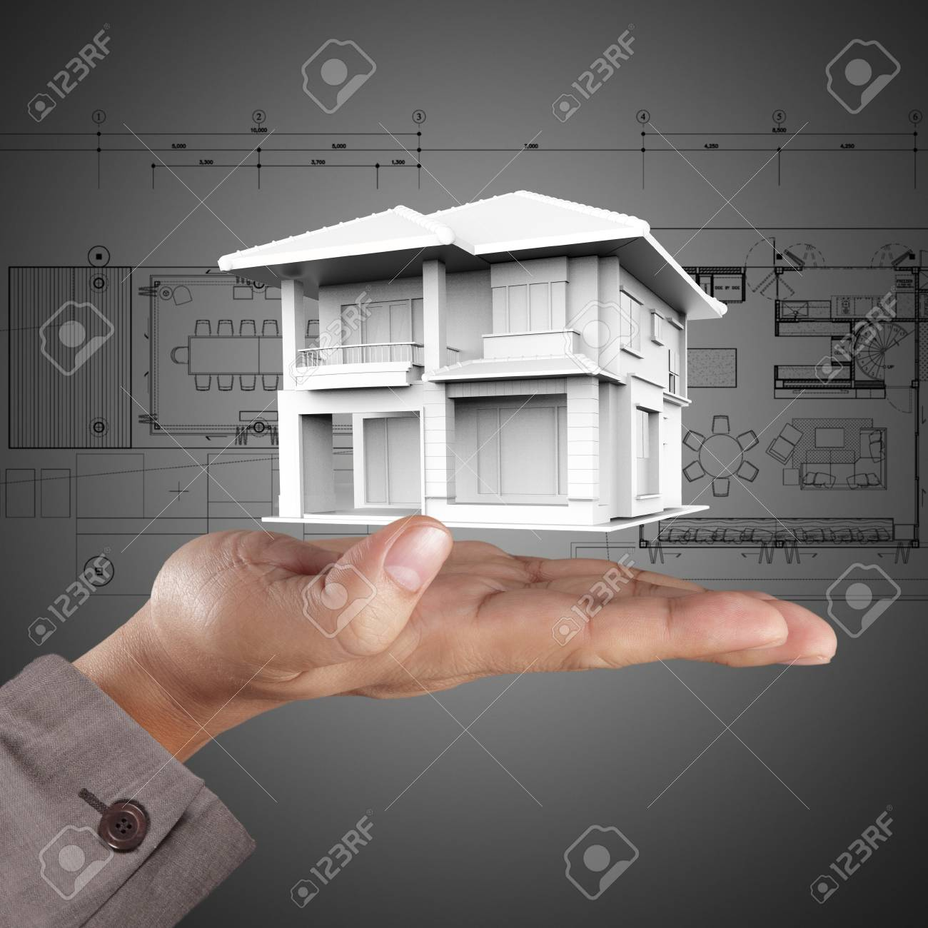 The house in hands on blue print Stock Photo - 14774853