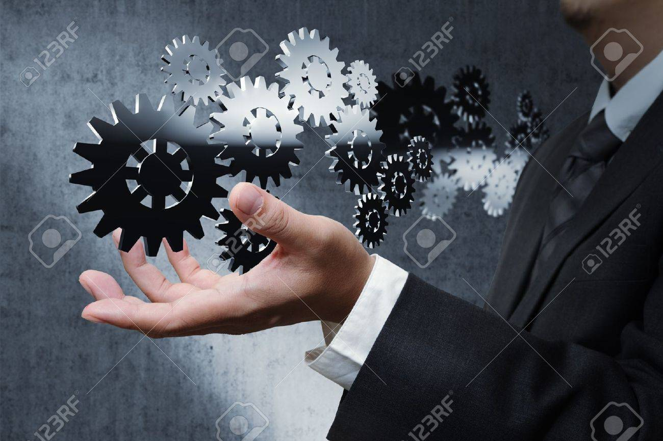 Young stylish businessman touching virtual interface button. Pillar of transparent blue light. Future bio style interior on background. Interfaces collection. - 16086762