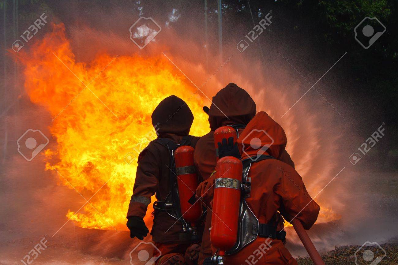 Firefighters fighting fire during training - 16087371