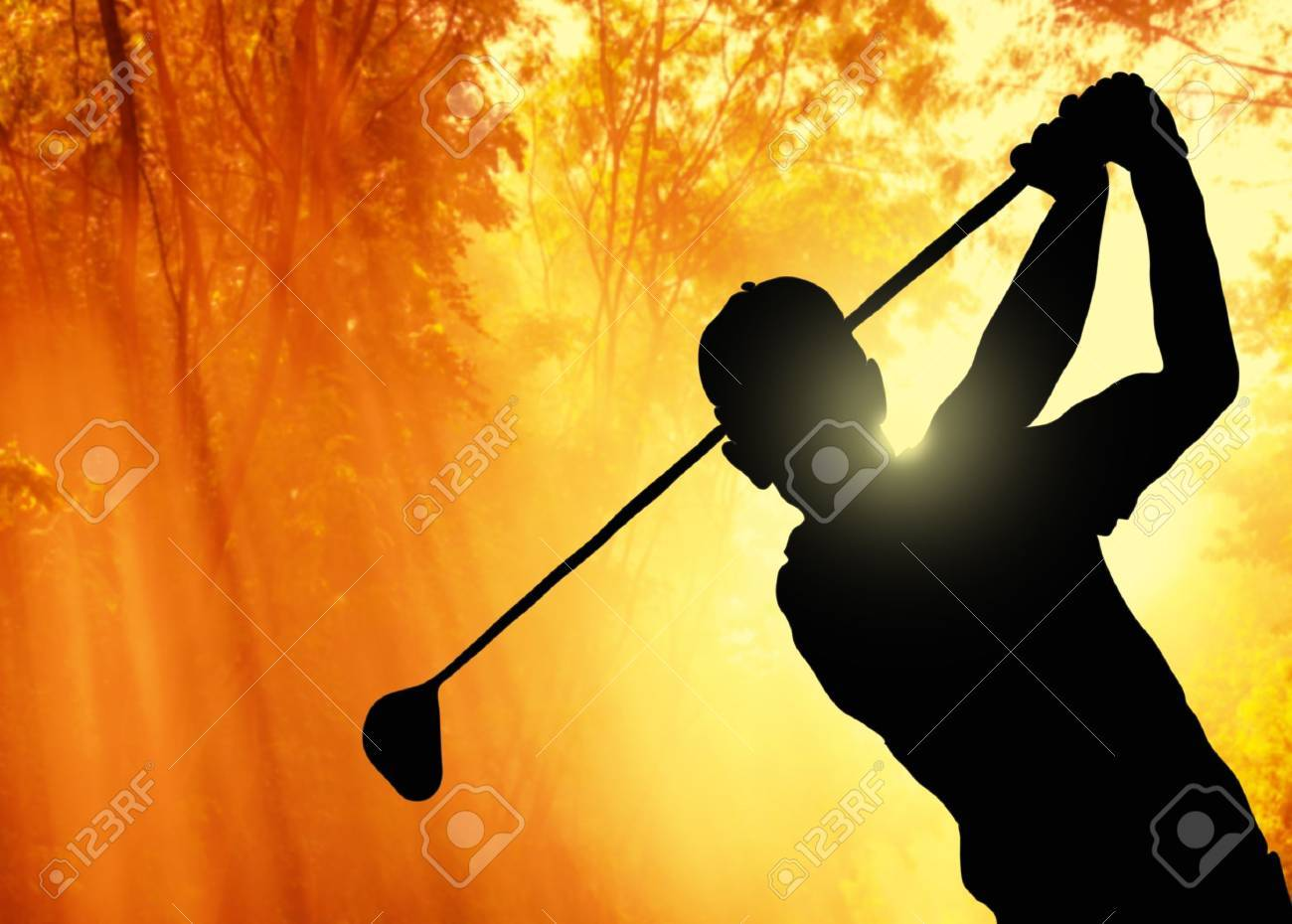 Golfer putting a ball on the green of a golf course - 16086689