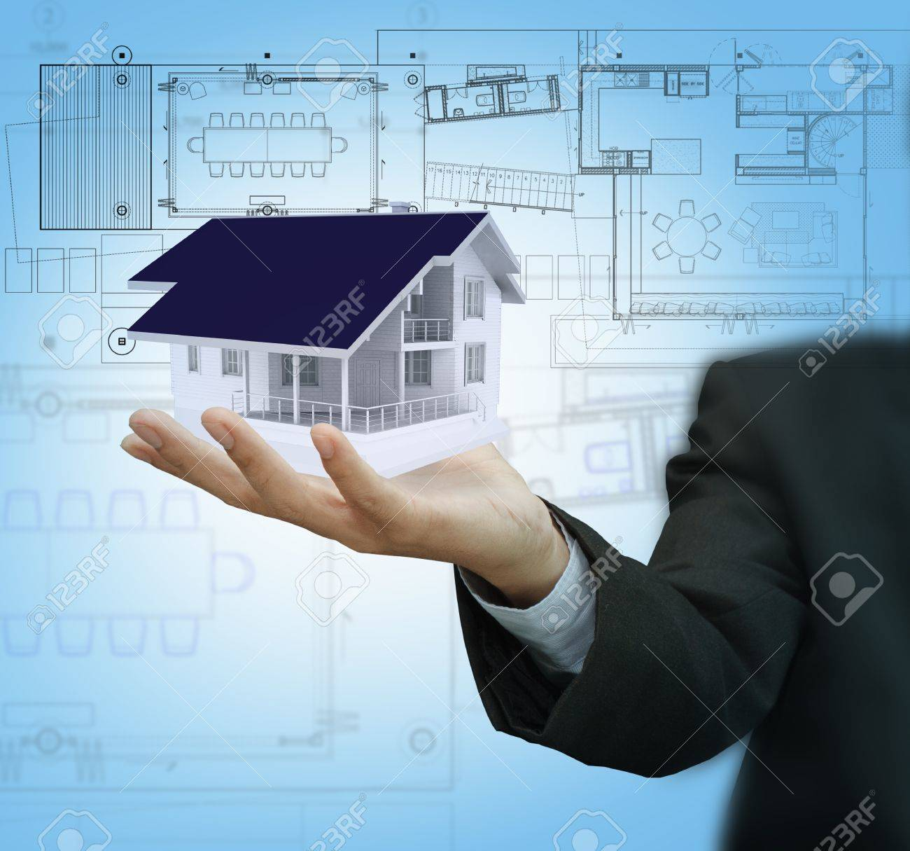Businessman present house model and plan on touch screen Stock Photo - 16080342
