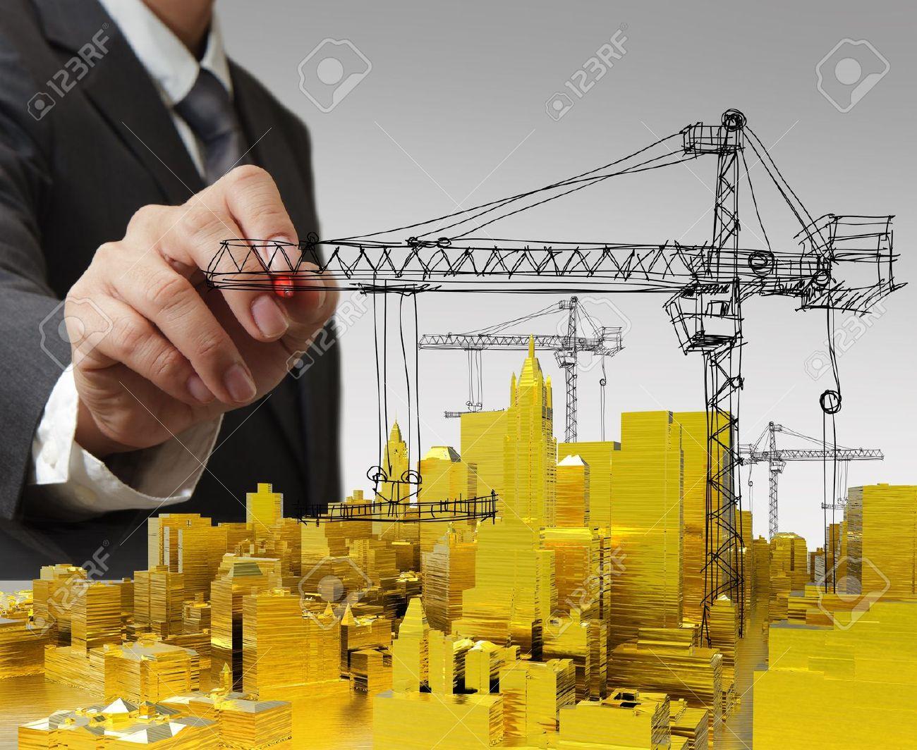 business man hand draws golden building development concept Stock Photo - 16081427