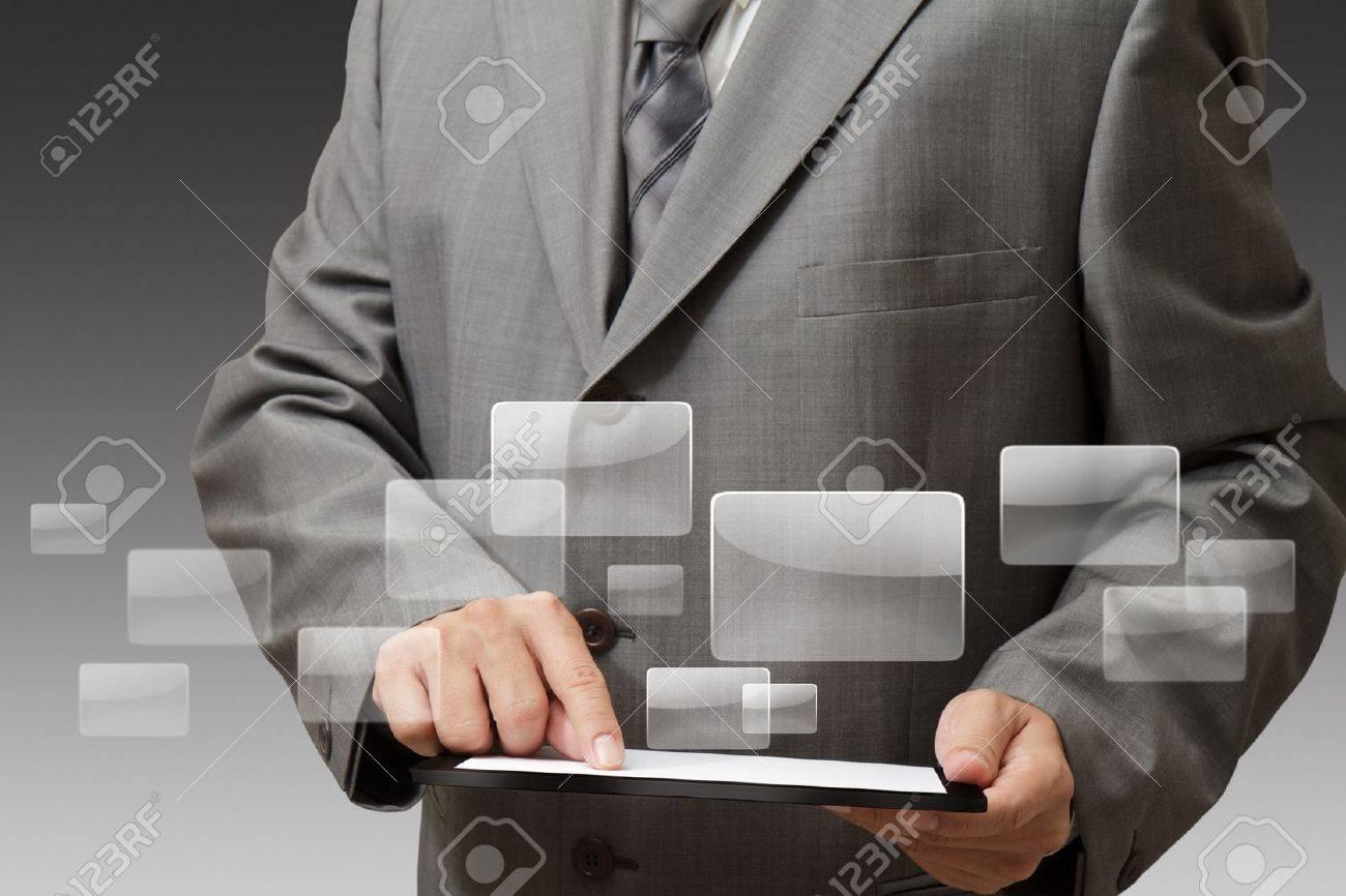 Handsome businessman using his digital tablet - 16097153