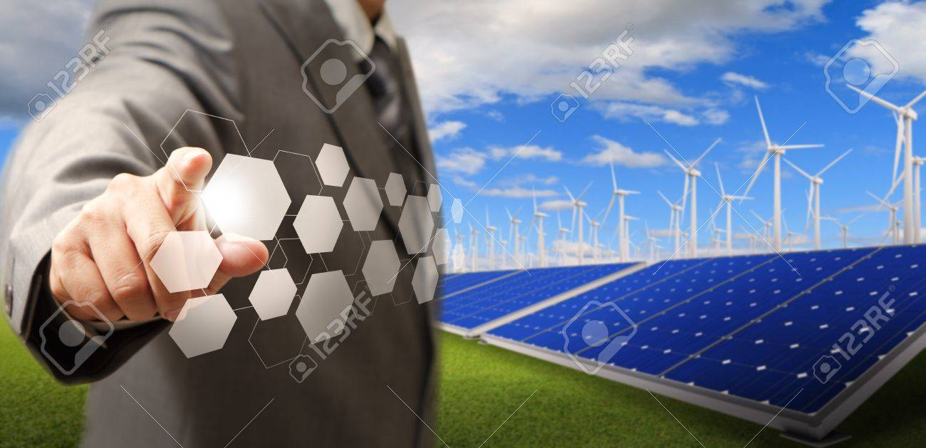 business man hand point virtual buttons and wind turbine and solar farm as concept - 16096297