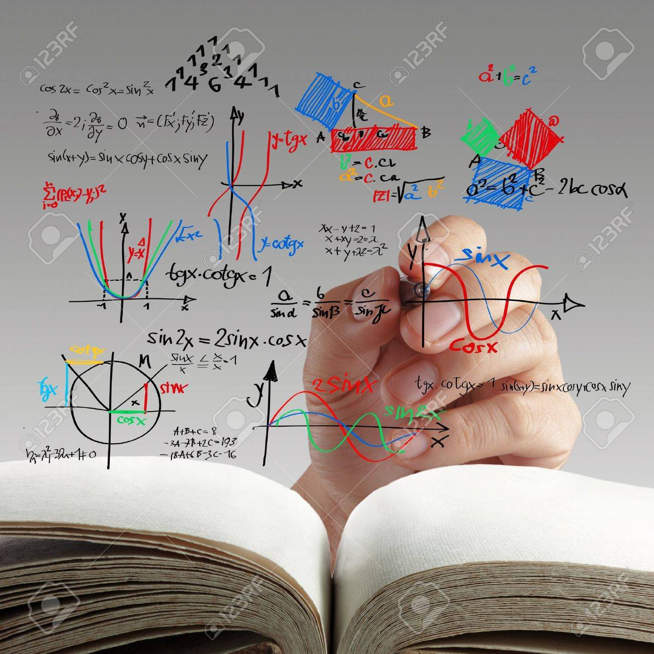 male teacher writing various high school maths and science formula on whiteboard Stock Photo - 16097317