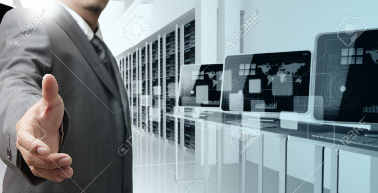 stock photo business man offers hand shake in computer center business computer