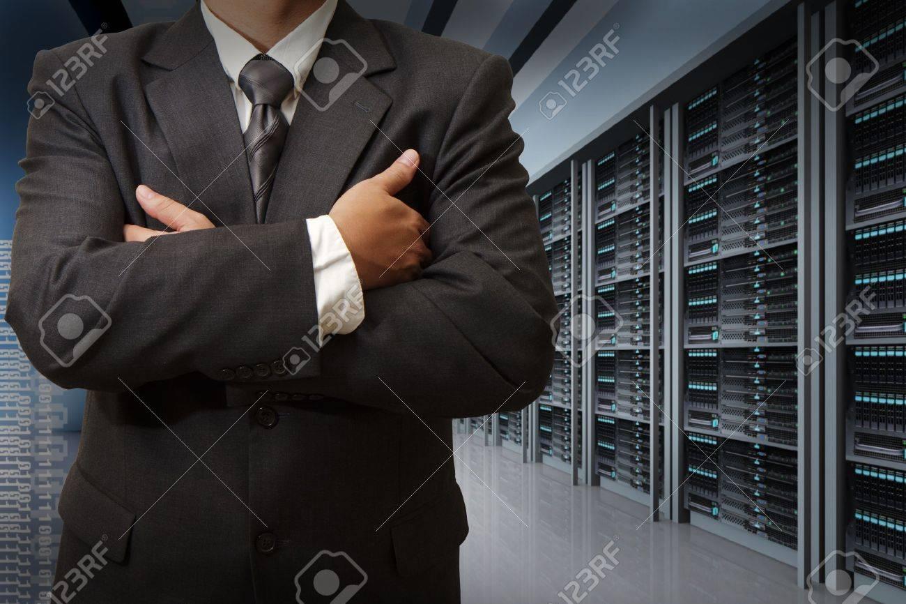 business man engineer in data center server room - 16097324
