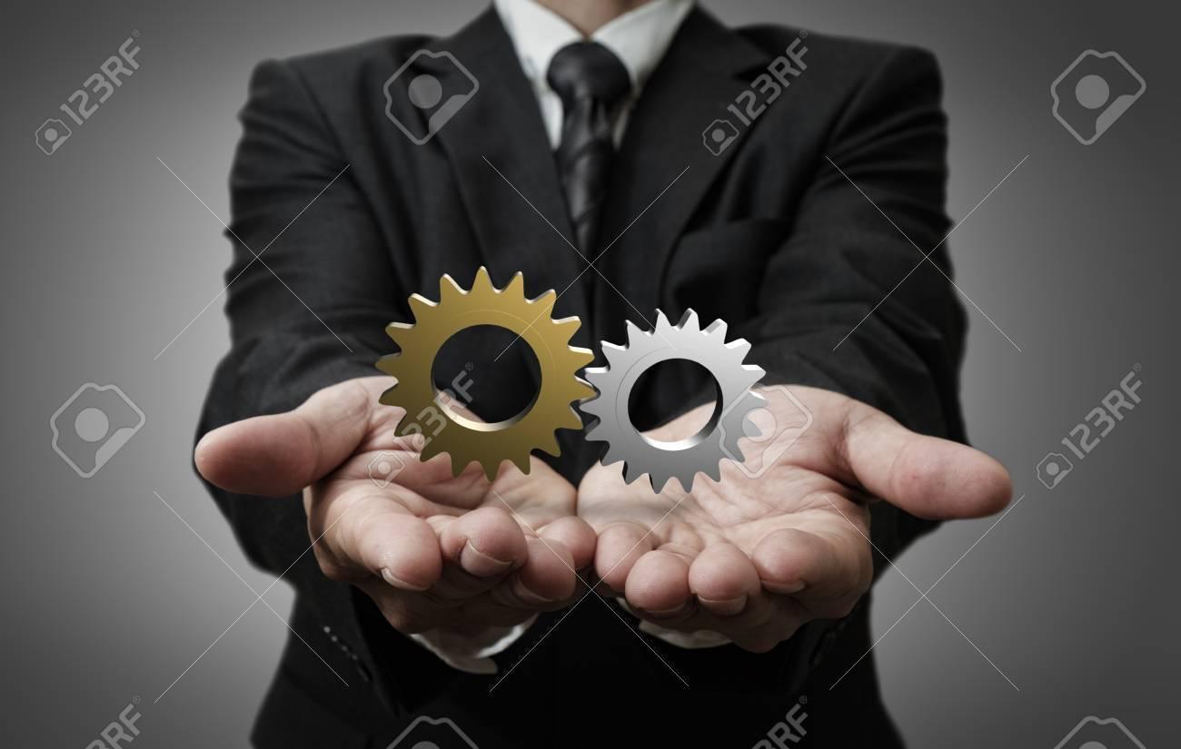business man hand shows 3d cogs as concept - 16083345
