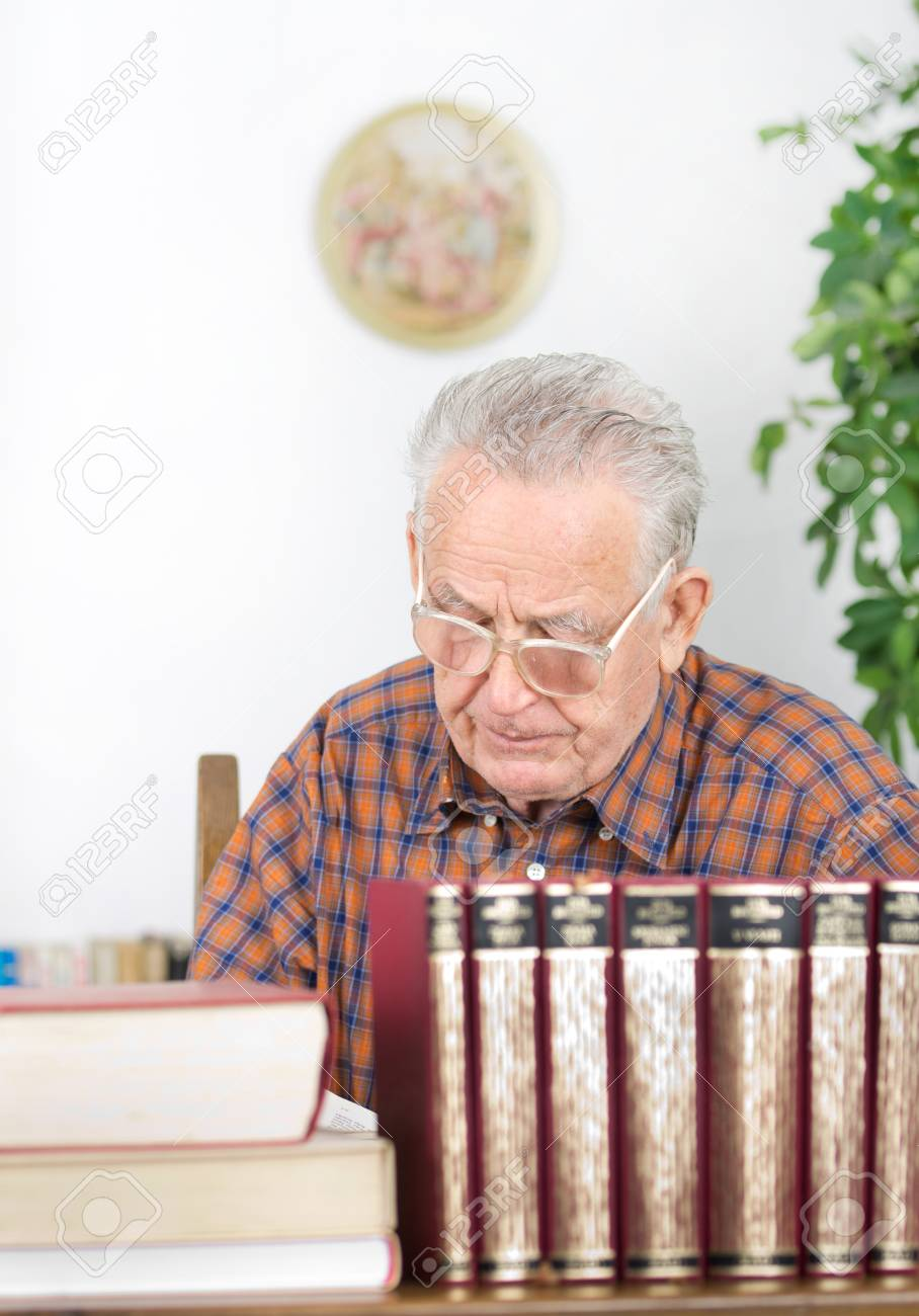 Old Man With Reading Glasses Reading Book In His Library Stock Photo,  Picture And Royalty Free Image. Image 25796945.