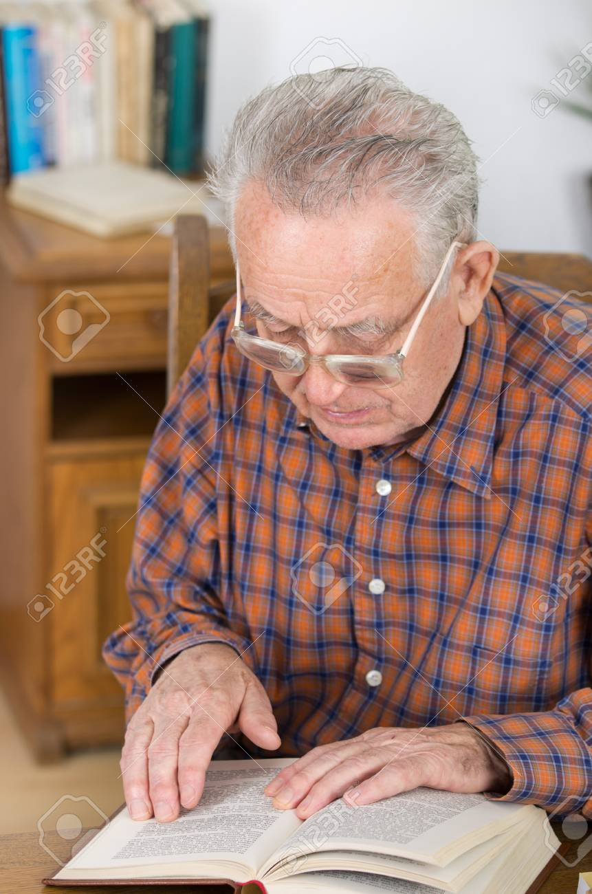 Old Man With Reading Glasses Reading Book In His Library Stock Photo,  Picture And Royalty Free Image. Image 25893133.