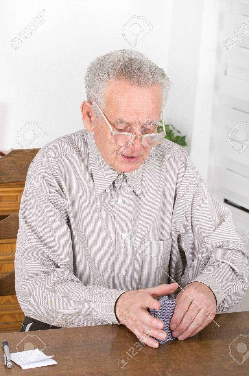 Old Man With Reading Glasses Collecting Cards For New Game Stock Photo,  Picture And Royalty Free Image. Image 26094886.