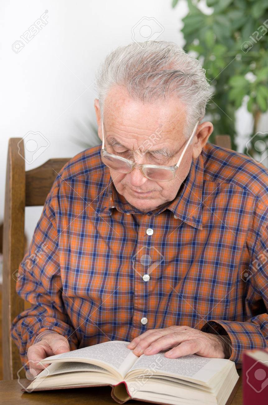 Old Man With Reading Glasses Reading Book In His Library Stock Photo,  Picture And Royalty Free Image. Image 26821646.
