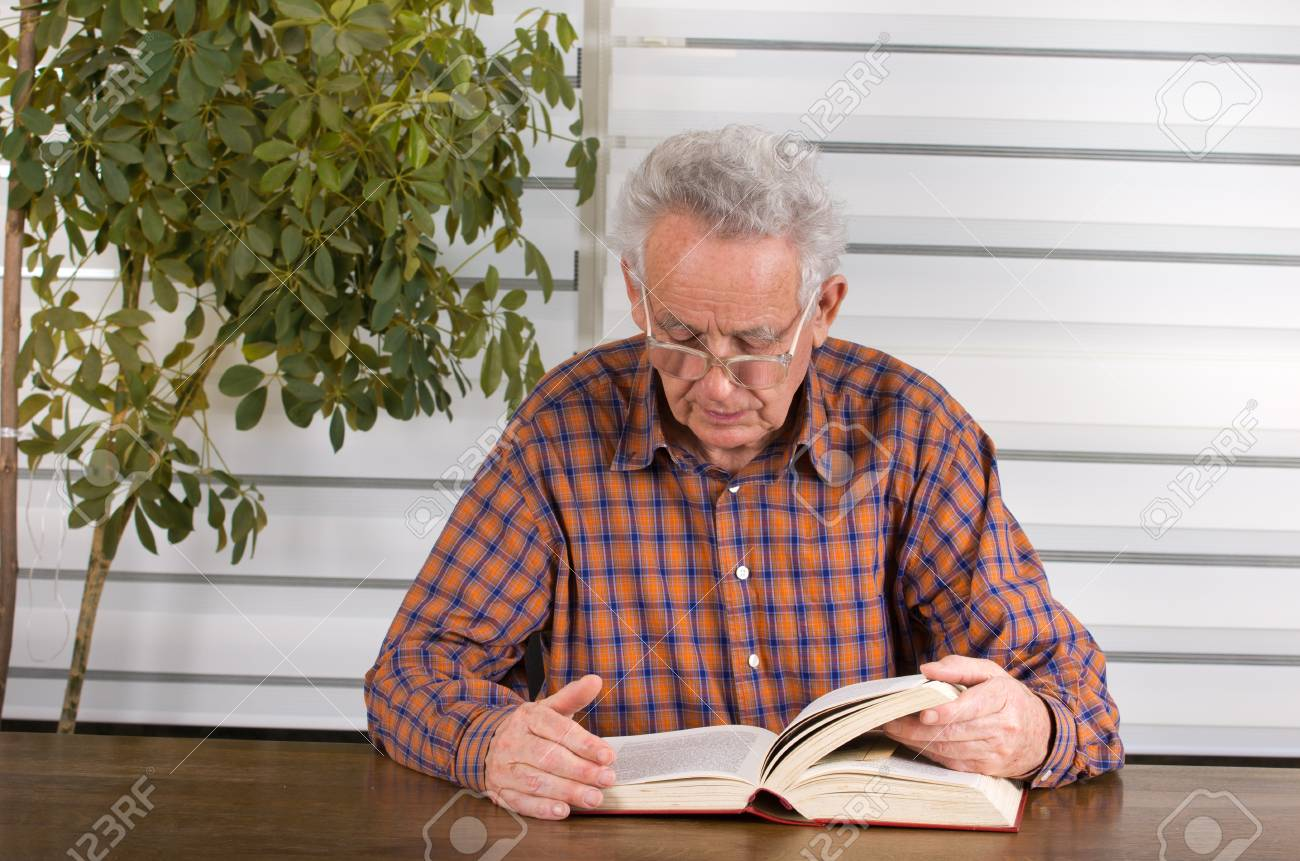 Old Man With Reading Glasses Reading Book In His Library Stock Photo,  Picture And Royalty Free Image. Image 34222375.