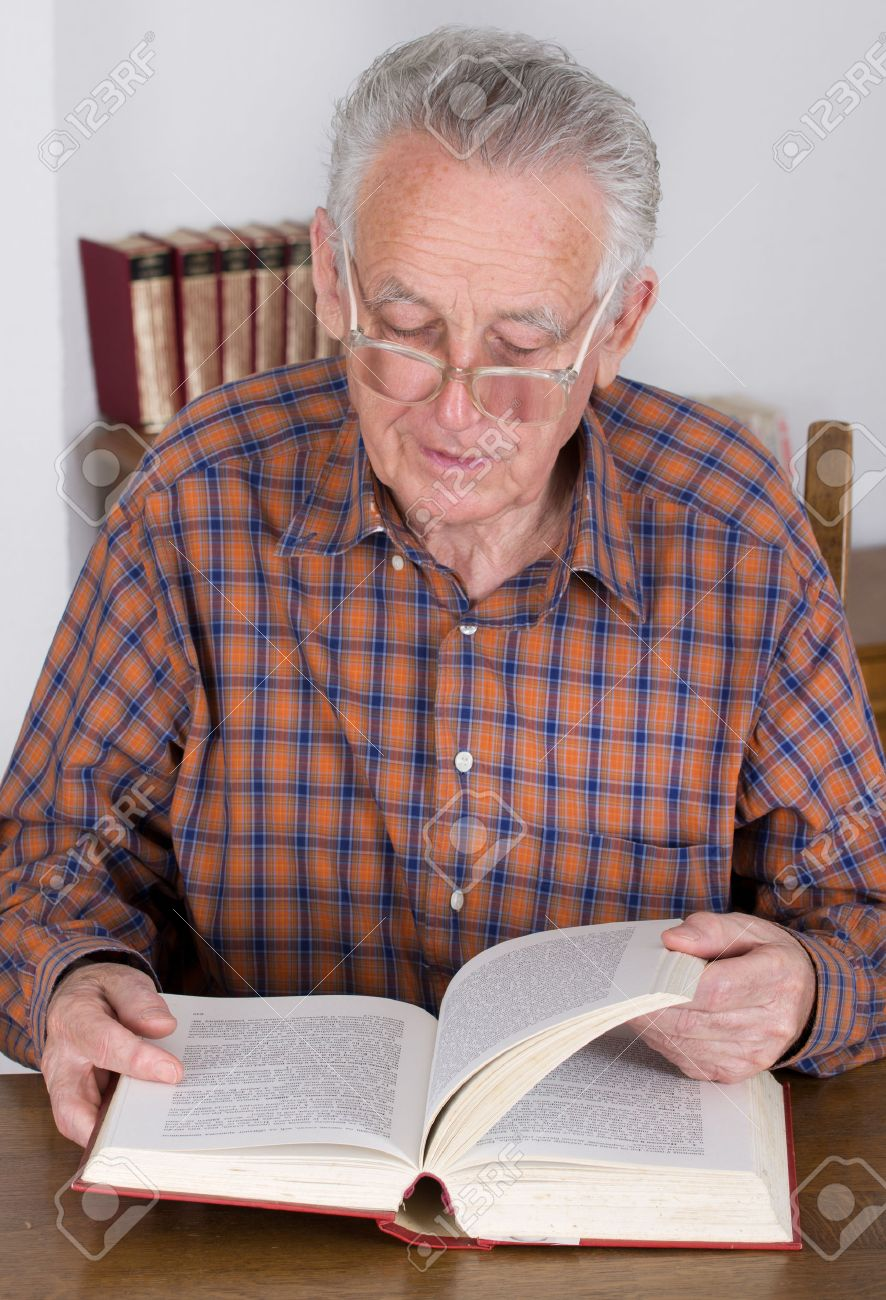 Old Man With Reading Glasses Reading Book In His Library Stock Photo,  Picture And Royalty Free Image. Image 35705536.