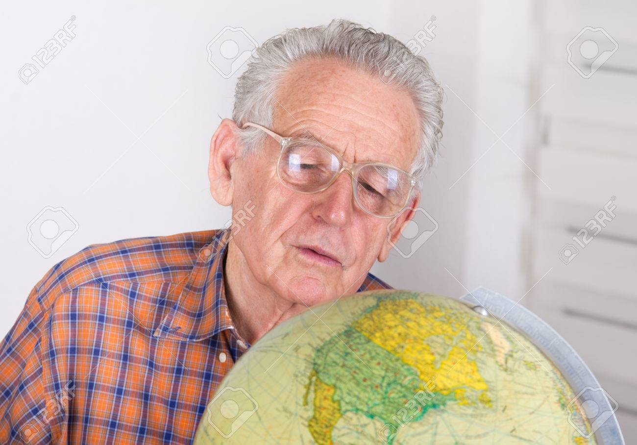 Close Up Of Old Man With Reading Glasses Looking At Globe Stock Photo,  Picture And Royalty Free Image. Image 38193606.