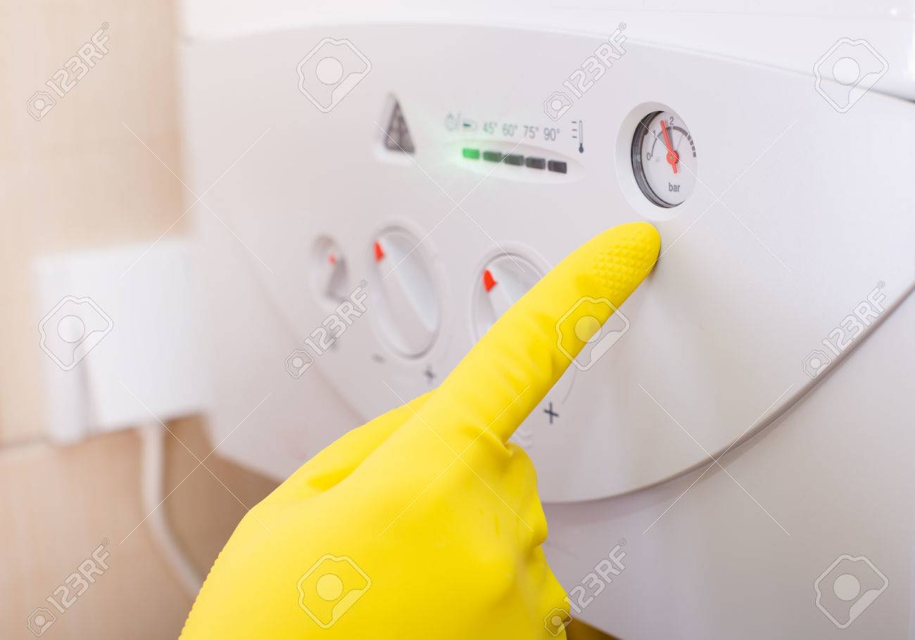 Close Up Of Human Hand With Safety Glove Pointing On Gas Boiler ...