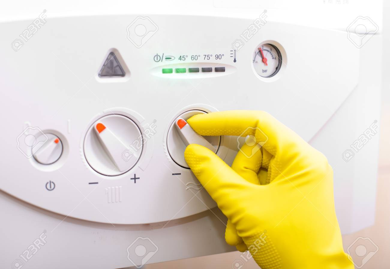 Close Up Of Human Hand With Safety Glove Turning On Gas Boiler ...