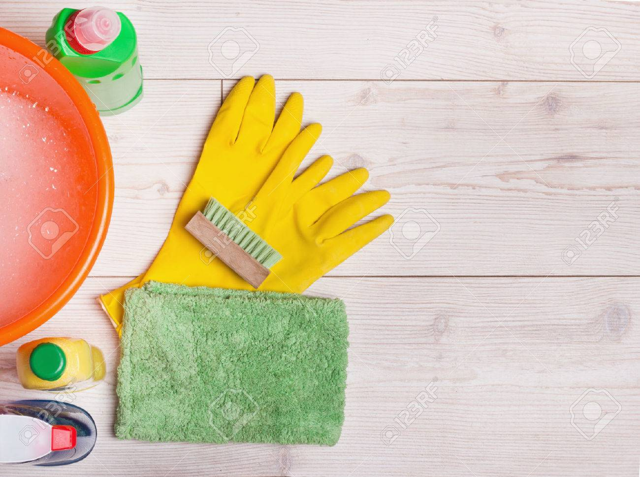 Top view of cleaning supplies and tools for house keeping on the bright laminate floor - 54614714