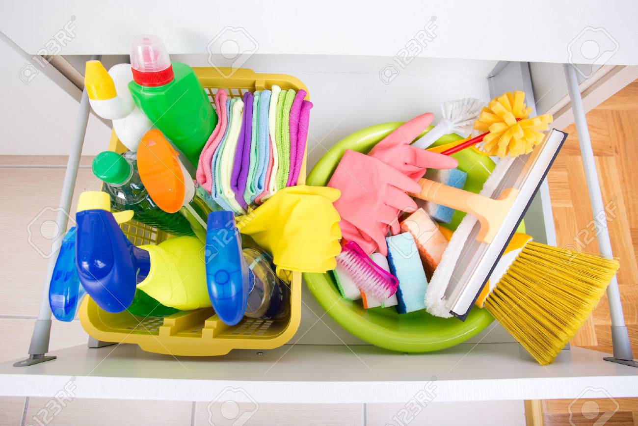 Top view of cleaning supplies and equipment stored in drawer..