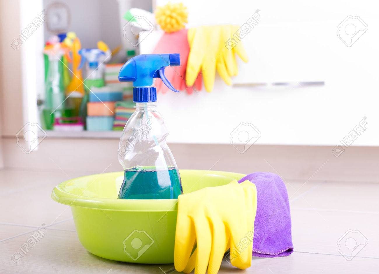 Spray Bottle And Cleaning Tools In Washbasin On The Kitchen Floor ...