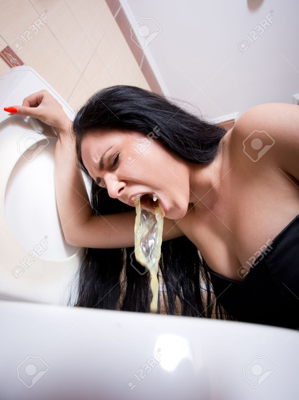 Asian girl eats her vomit bowl