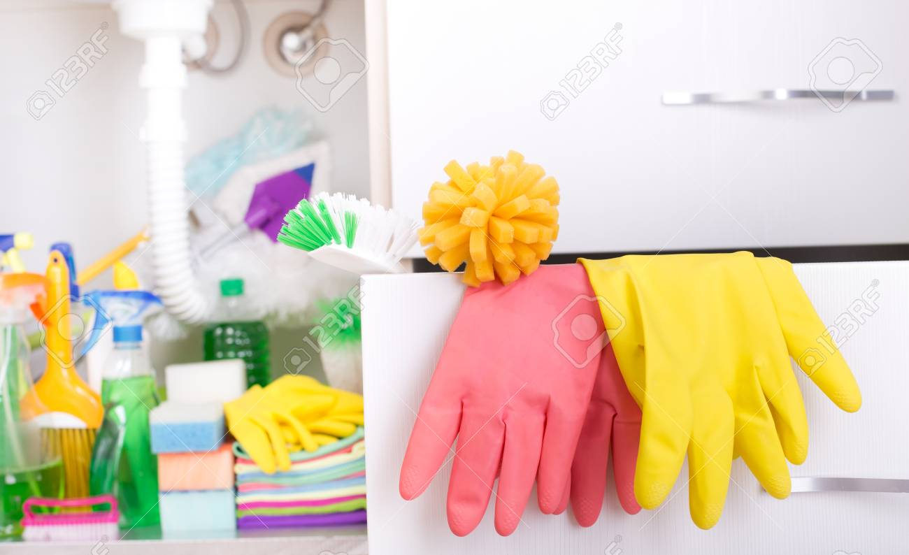 Set Of Cleaning Supplies And Equipment In Drawer And In Sink