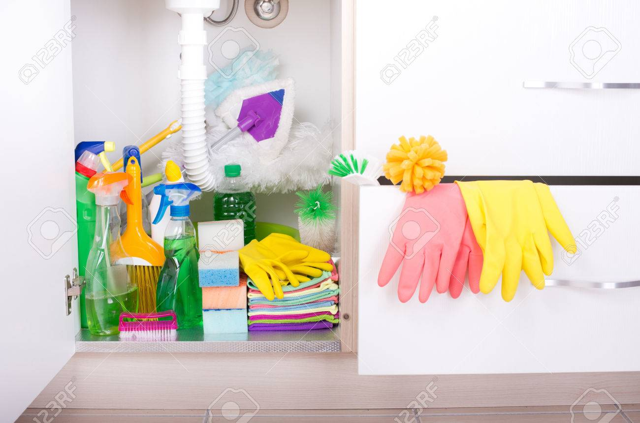 Set Of Cleaning Supplies And Equipment In Sink Cabinet In Kitchen ...