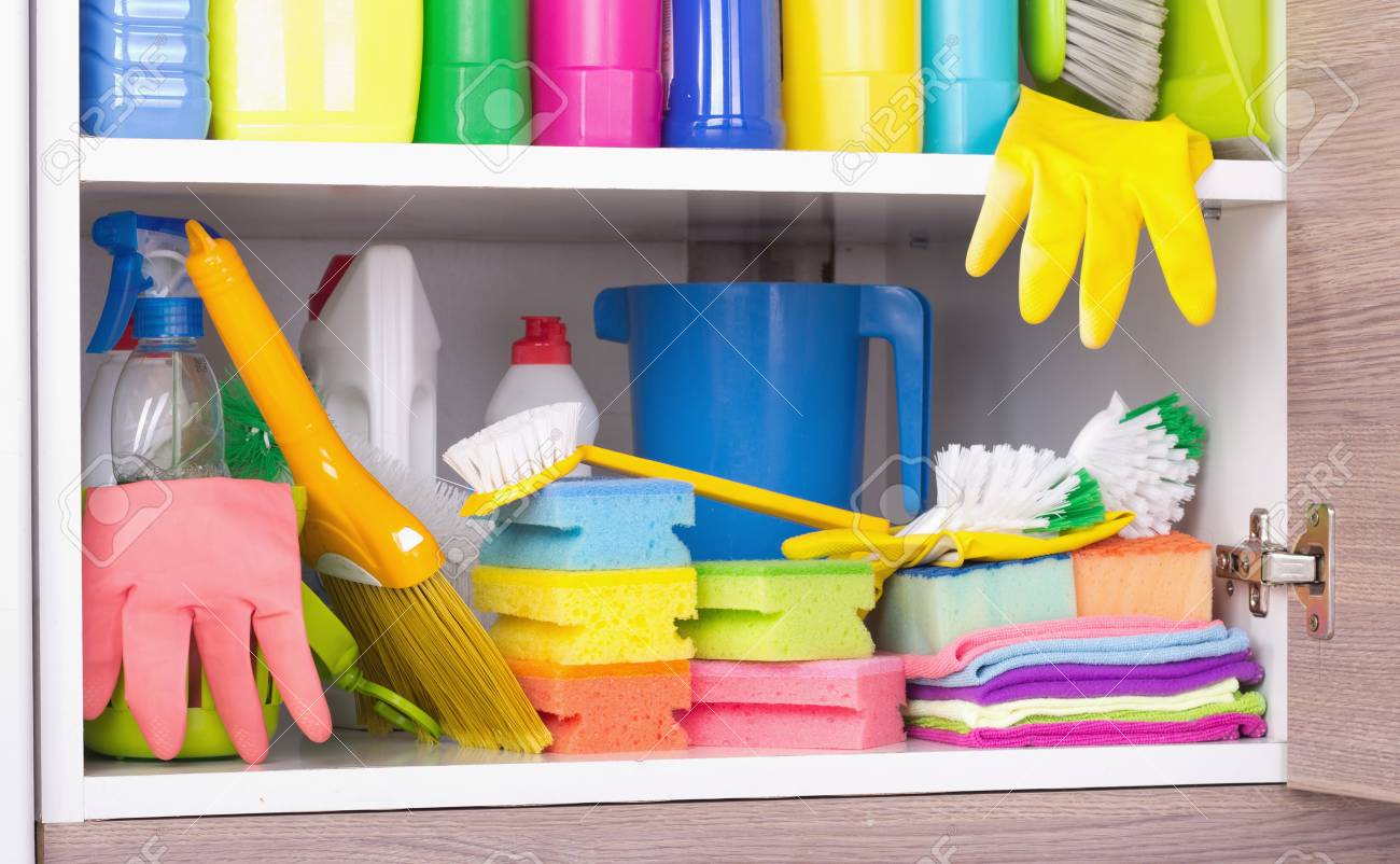 Cleaning products and equipment placed in kitchen cabinet. Housekeeping..