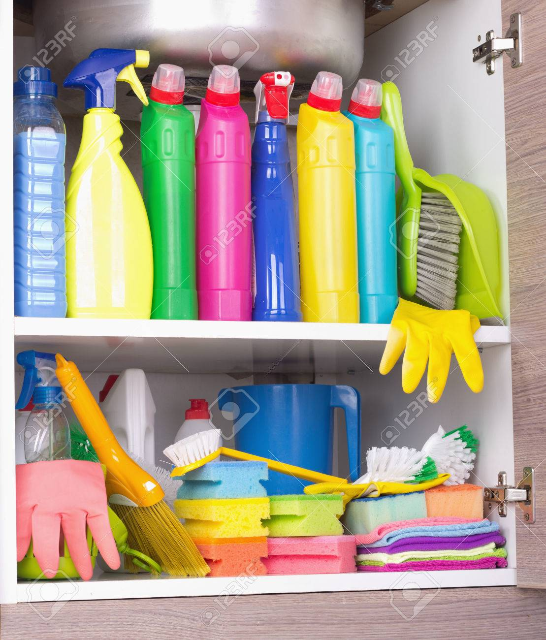 Cleaning products placed in kitchen cabinet under sink. Housekeeping..