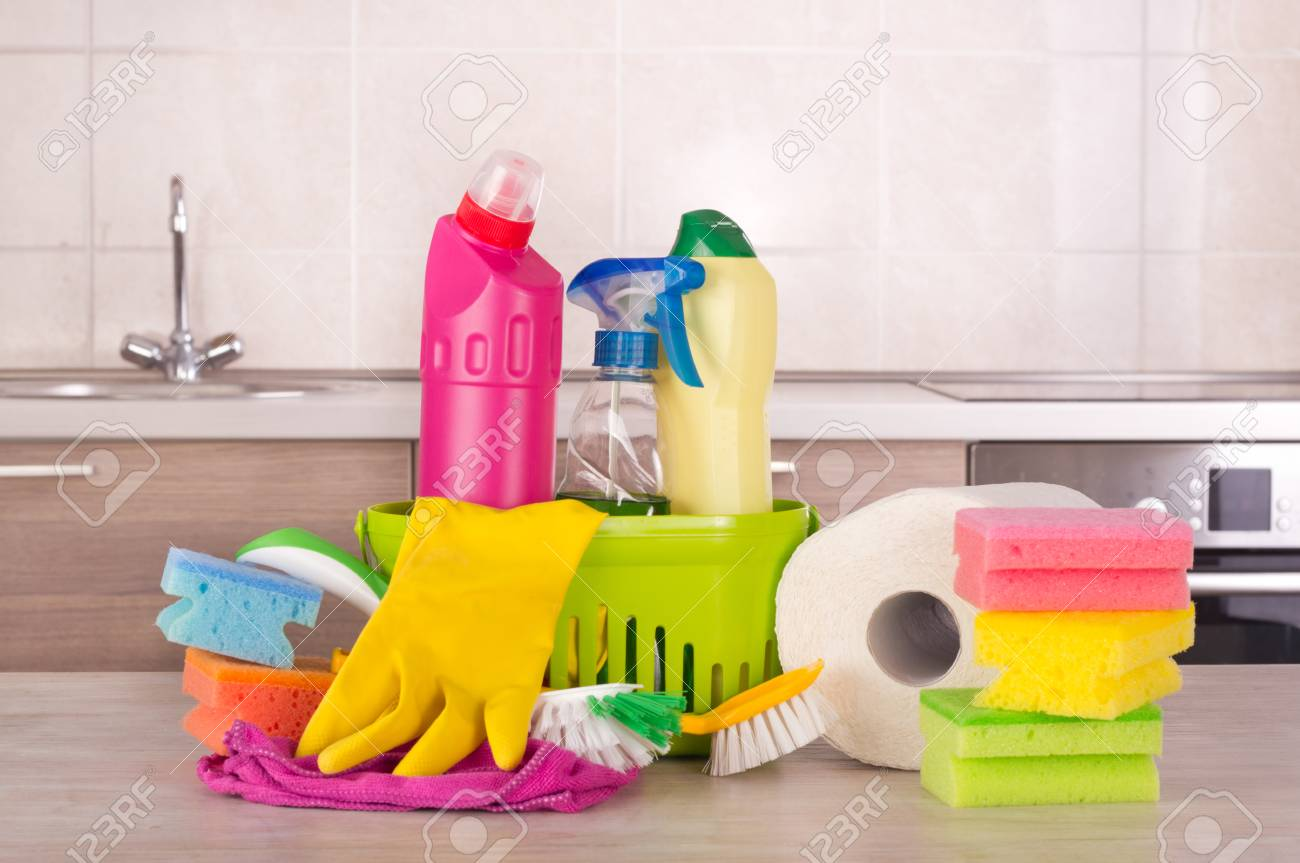 Cleaning products and equipment on table in front of kitchen..