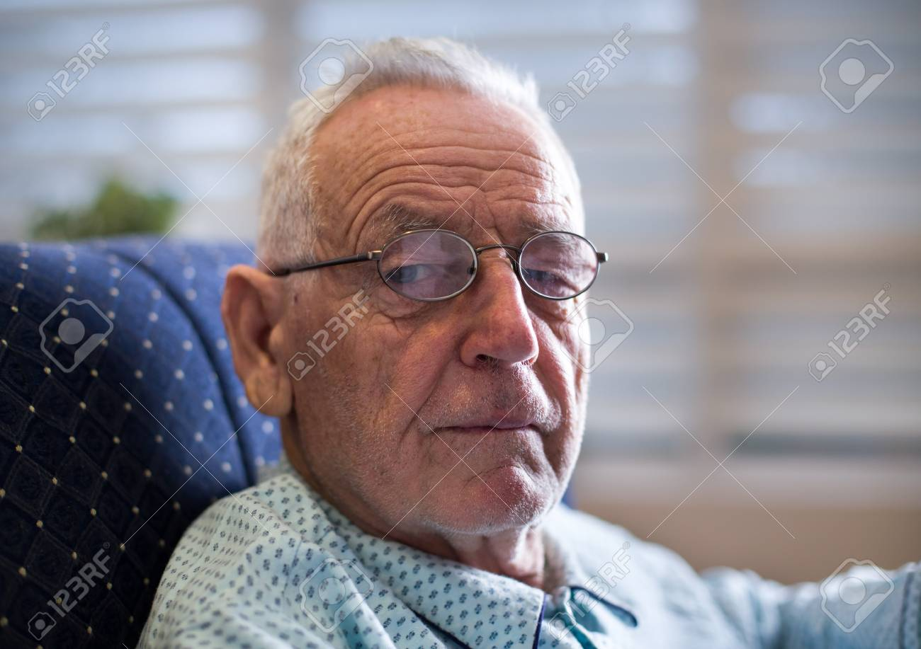 Portrait Of Old Man In 80's Sitting On Sofa In Pajamas, Wearing.. Stock  Photo, Picture And Royalty Free Image. Image 94256245.