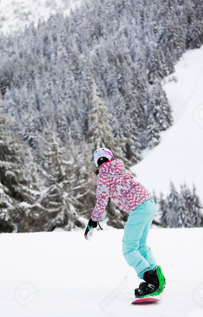 Young Woman On Snowboard Riding On Slope Of Kopaonik Mountains