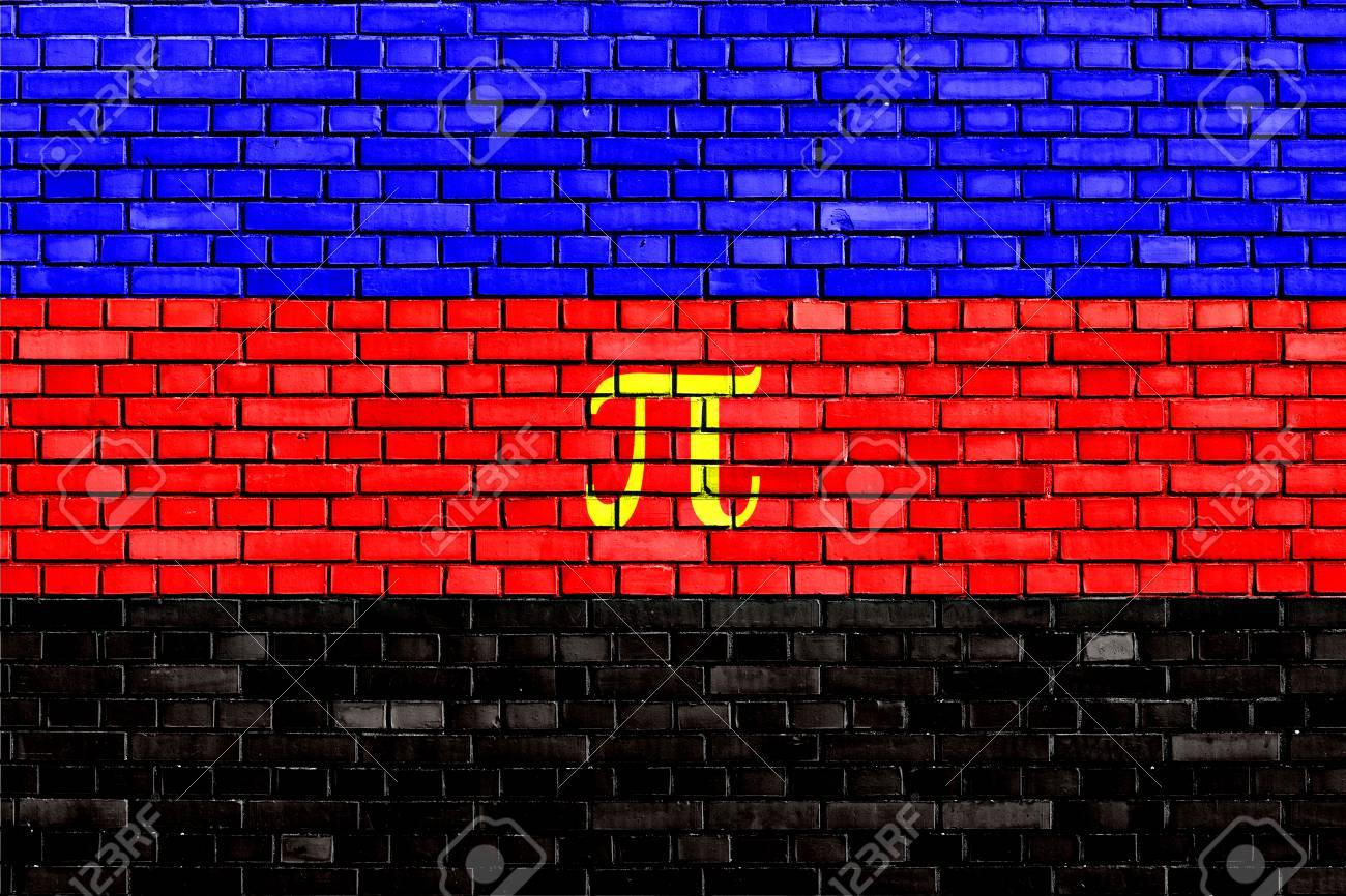 Polyamory flag painted on brick wall
