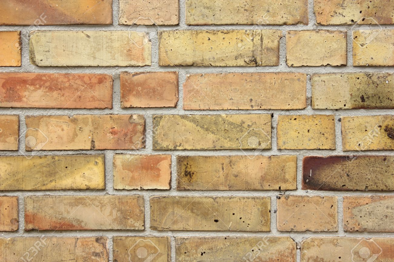 Brick Wall Light: Brick wall light brown big stones Stock Photo - 16921318,Lighting