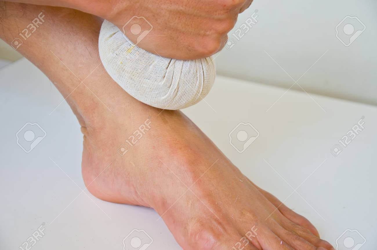 foot massage with herbal compressball Stock Photo - 25903183