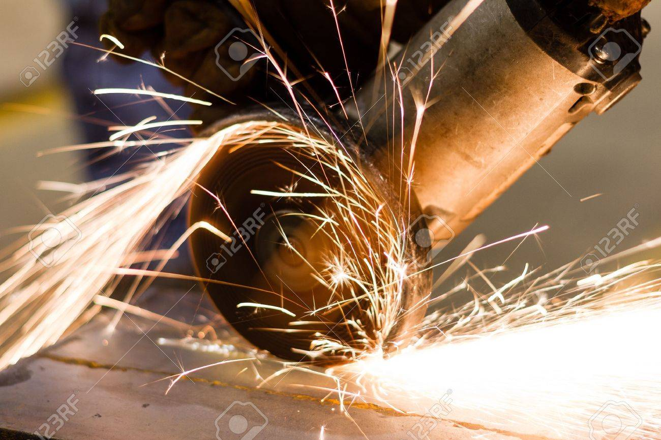 Worker cutting metal with many sharp sparks Stock Photo - 15915357