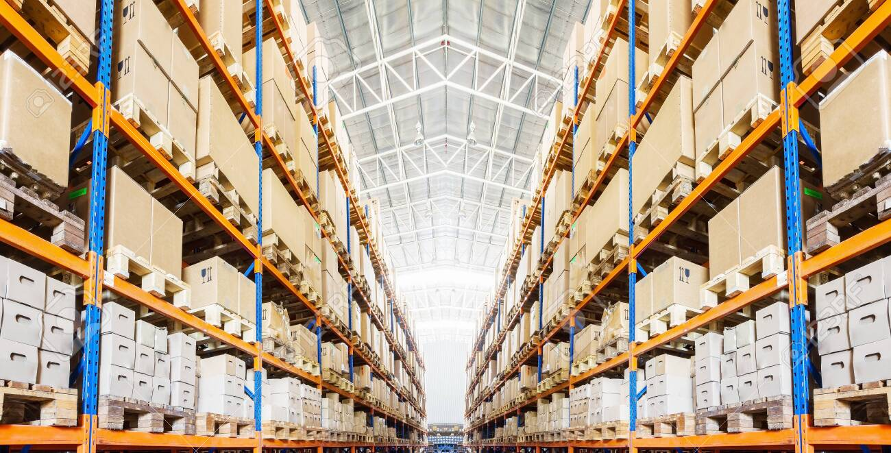Rows of shelves with boxes in modern warehouse - 136885320