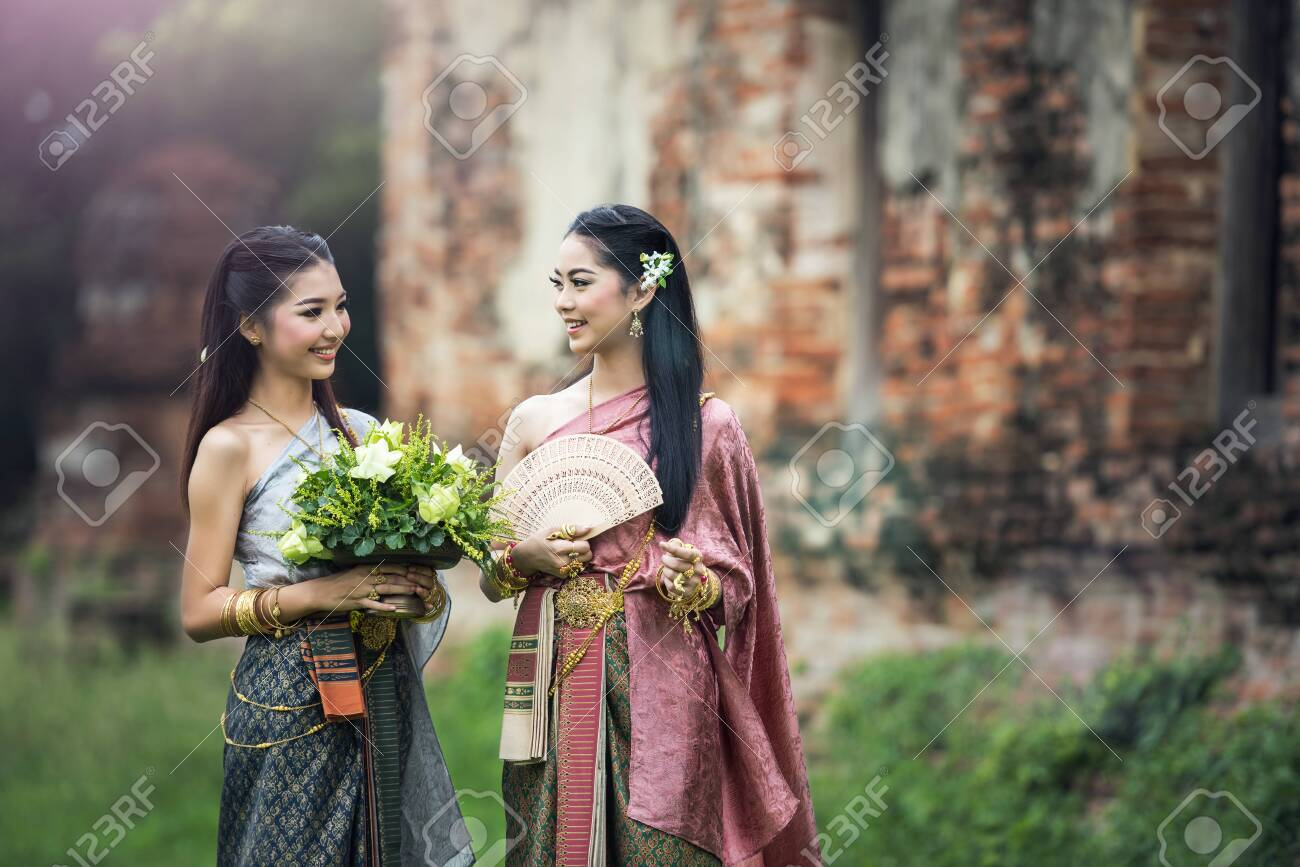 Asian woman wearing typical (traditional) Thai dress, vintage original Thailand attire , identity culture of Thailand - 136958257