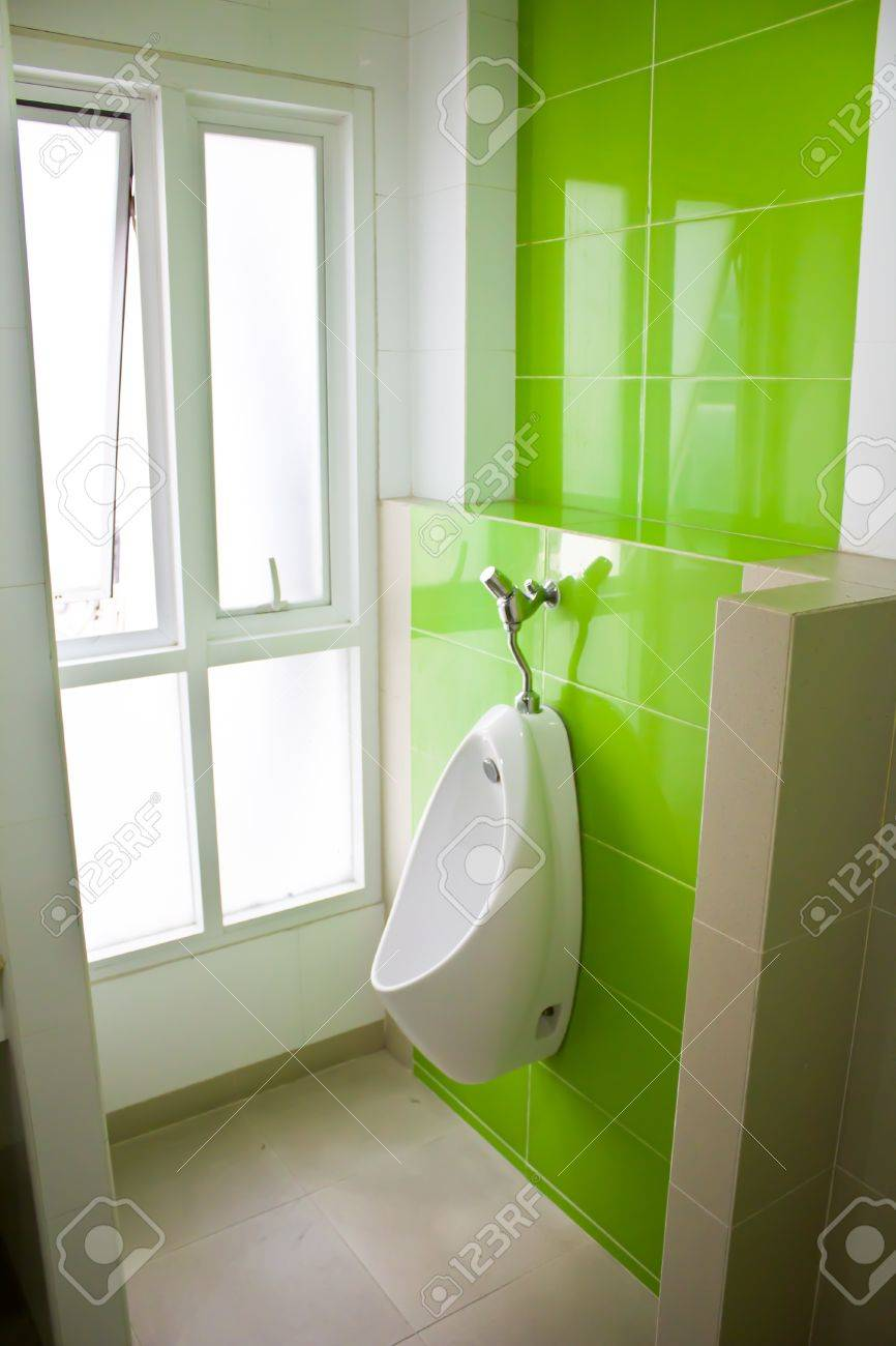 Urinal In The Bathroom With A Green Wall Stock Photo   13748083