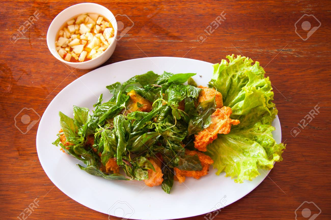 Thai Food (Tod Mun) fried fish mix herbs served with sweet chili sauce Stock Photo - 10557885