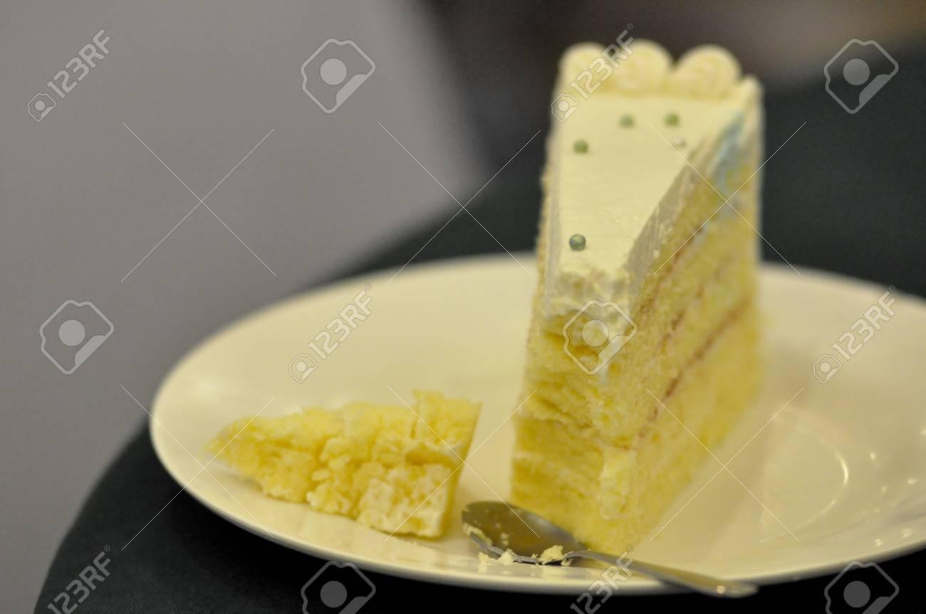 cut slice of sponge cake with cream and strawberry jam decorating