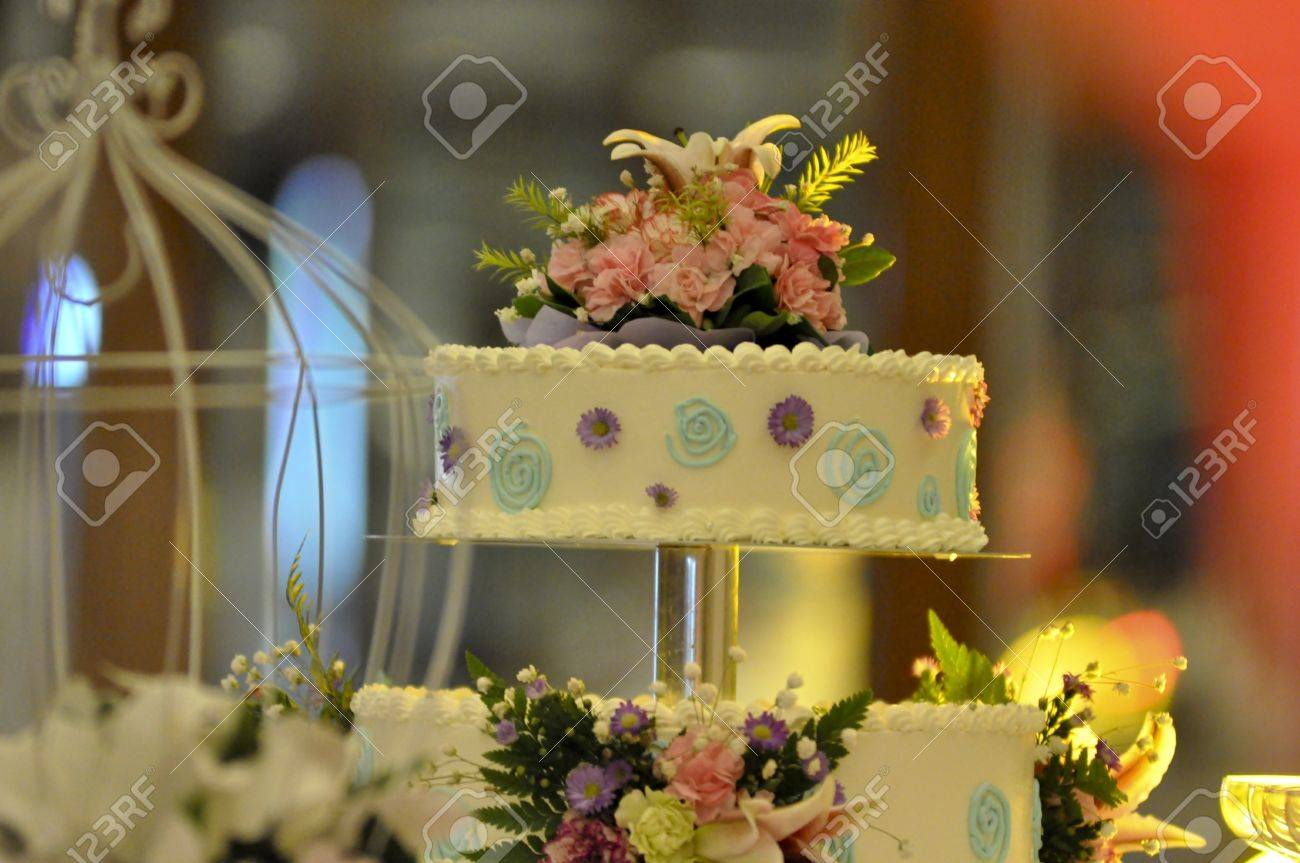 Two Tiers Wedding Cake With Colourful Cream Drawing Around And