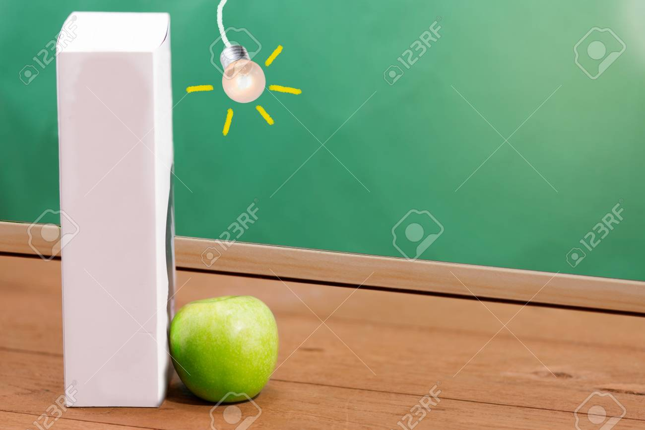 Text Book And Green Apple With Chalkboard Background Copy