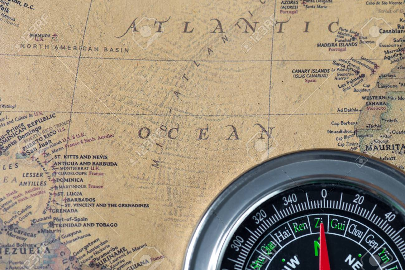 Black Compass On Old Vintage Map Atlantic Ocean Macro Background Stock Photo