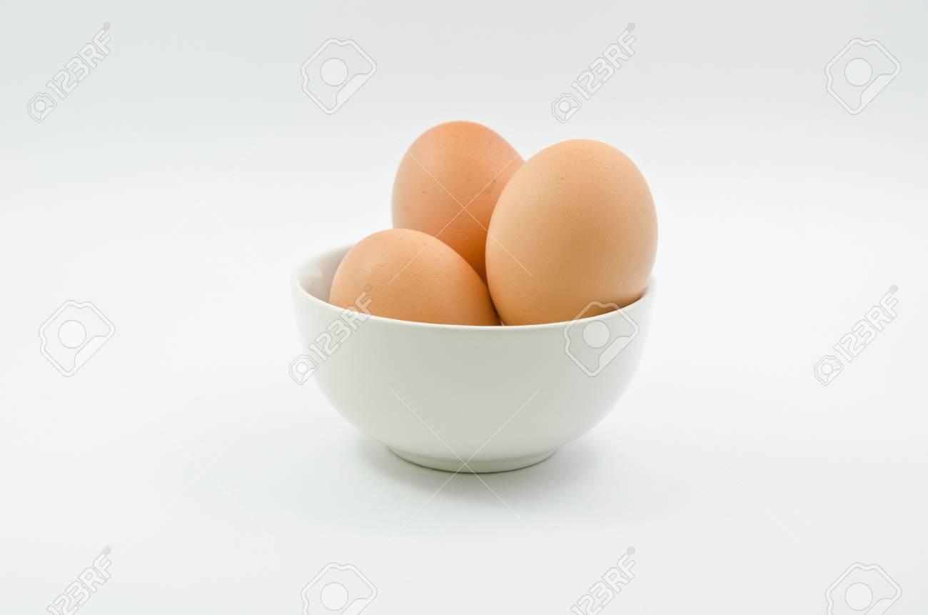 Three eggs in bowl on white background Stock Photo - 13630397